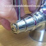 Removing Indicator from Tap Handle to access screw underneath.